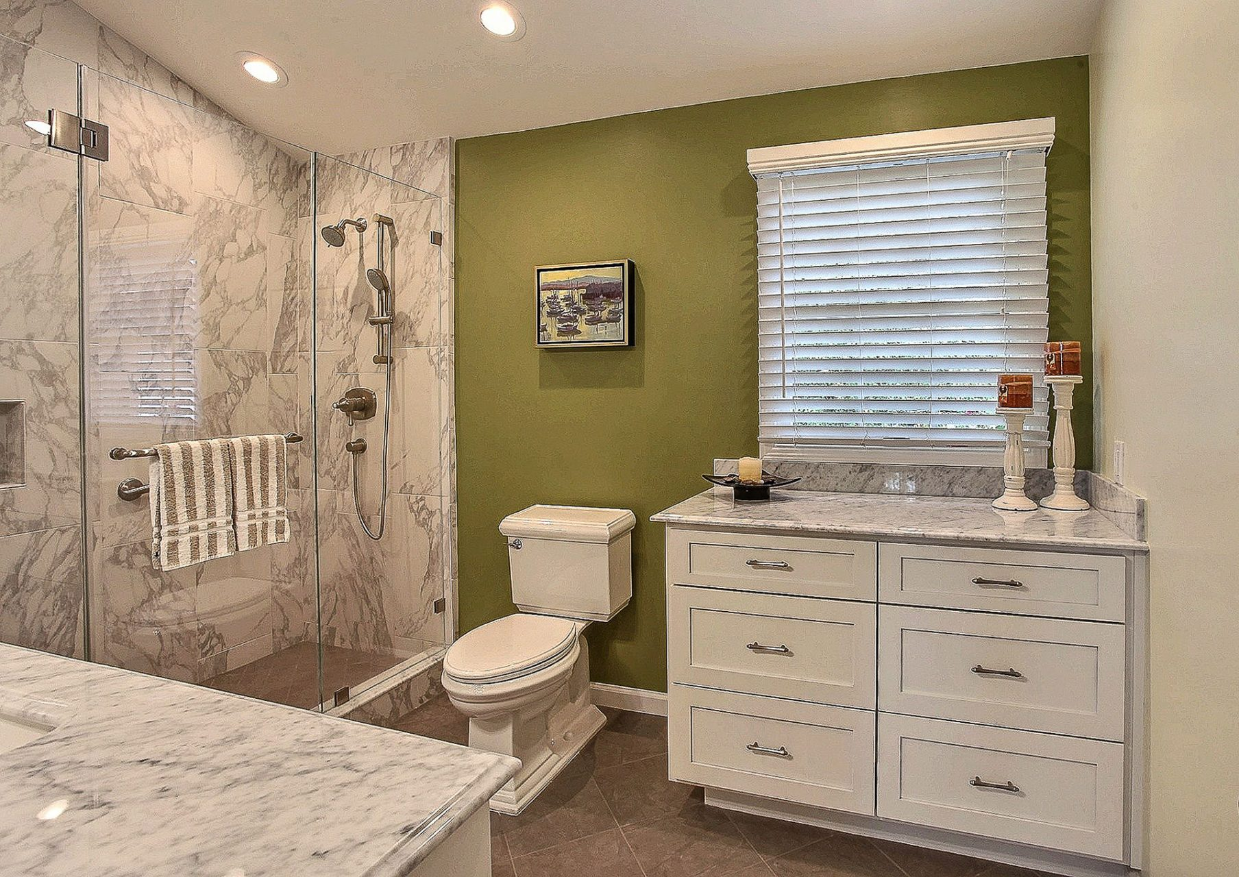 white toilet and cabinets