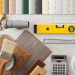 Do it yourself home renovation and construction concept with DIY tools hardware and swatches on wooden table top view