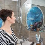 Mermaid trend bathroom with woman standing in front of mirror