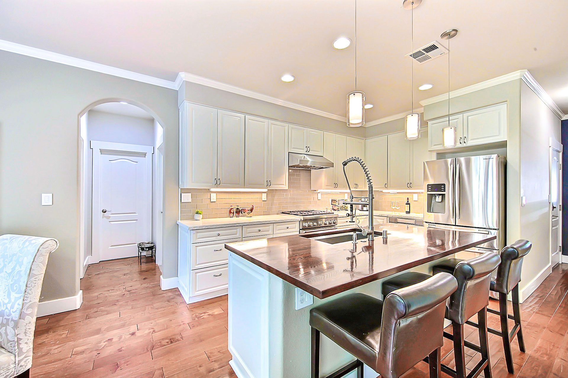 Original kitchen before being remodeled into a contemporary space with traditional design